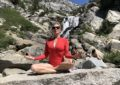 meditating in a red bathing suit