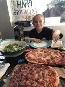 It shows a picture of my son on his 8th birthday with pizza.